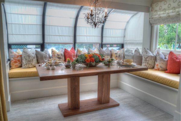 Vonk's handcrafted wood table stands as a charming focal point in the colorful breakfast nook.